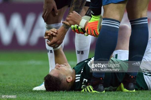 Teammates check on Mexico's forward Javier Hernandez after resulting injured during the Russia 2018 World Cup Group F football match between Germany...