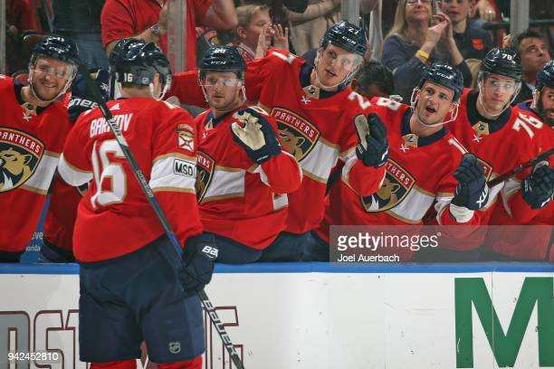 Teammates congratulate Aleksander Barkov of the Florida Panthers after he scored a first period goal against the Boston Bruins at the BBT Center on...