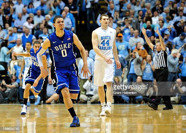Teammates congratulate Austin Rivers of the Duke Blue Devils after his lastsecond gamewinning three point basket over Tyler Zeller of the North...
