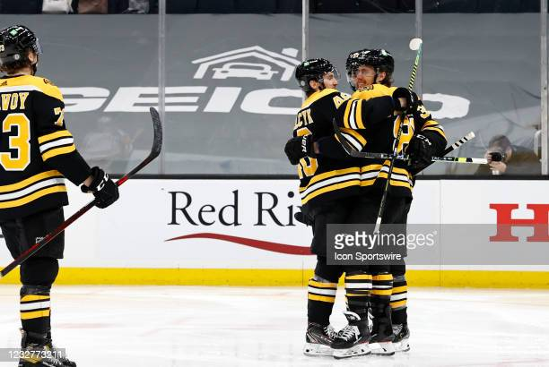Teammates congratulate Boston Bruins right wing David Pastrnak on his 200th goal during a game between the Boston Bruins and the New York Rangers on...