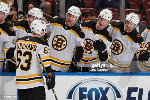 Teammates congratulate Brad Marchand of the Boston Bruins after he scored a second period goal against the Florida Panthers at the BBT Center on...