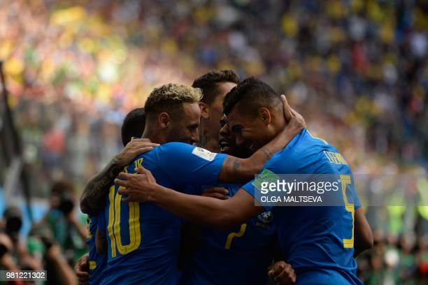 TOPSHOT Teammates congratulate Brazil's forward Neymar for his goal during the Russia 2018 World Cup Group E football match between Brazil and Costa...