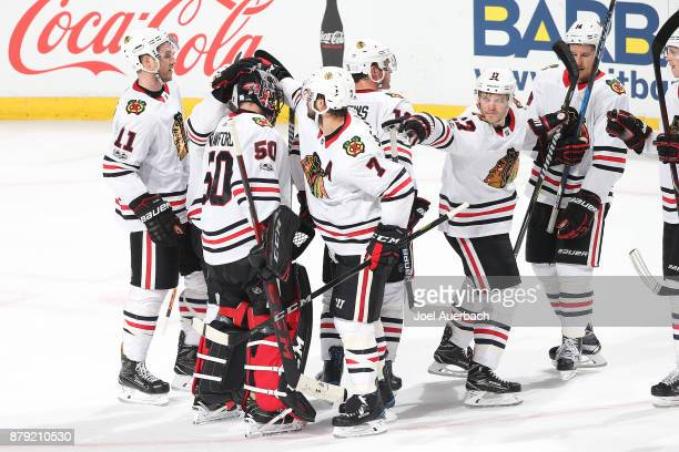 Teammates congratulate goaltender Corey Crawford of the Chicago Blackhawks after the game against the Florida Panthers at the BBT Center on November...