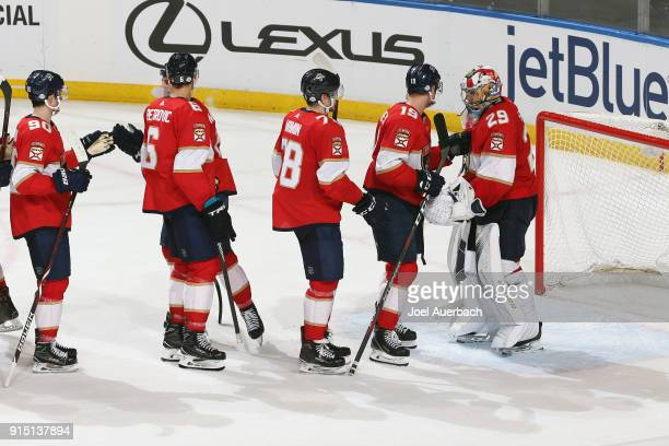 Teammates congratulate goaltender Harri Sateri of the Florida Panthers after the win against the Vancouver Canucks at the BBT Center on February 6...