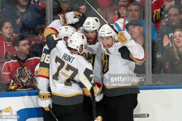 Teammates congratulate James Neal of the Vegas Golden Knights after he scored a third period goal to tie the game against the Florida Panthers at the...