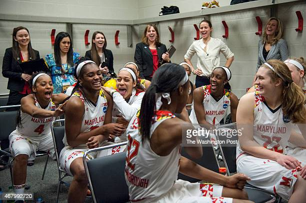 Teammates congratulate Maryland Terrapins guard Kiara Leslie as Maryland Terrapins head coach Brenda Frese gives a shout out to her game in the...