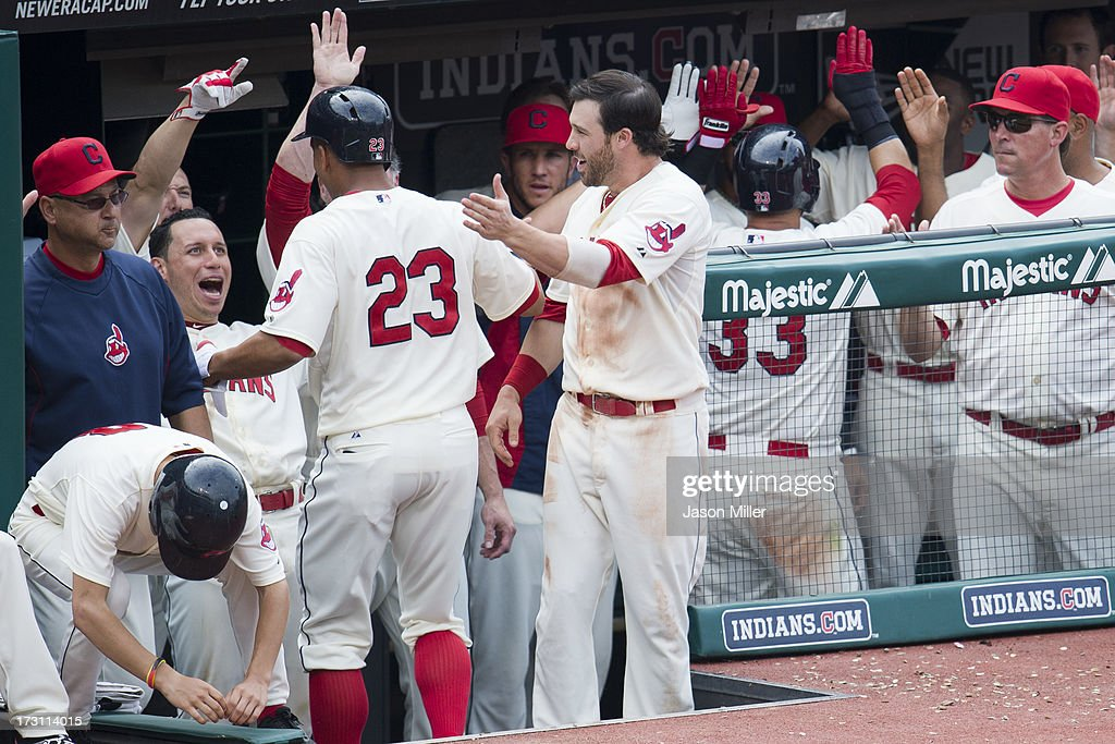 Teammates congratulate Michael Brantley #23 of the Cleveland Indians after he hit a two run home run during the eighth inning to take the lead over the Detroit Tigers at Progressive Field on July 7, 2013 in Cleveland, Ohio. The Indians defeated the Tigers 9-6.