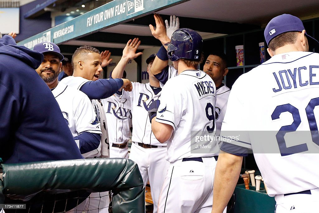 Teammates congratulate outfielder Wil Myers #9 of the Tampa Bay Rays after he scored against the Houston Astros during the game at Tropicana Field on July 13, 2013 in St. Petersburg, Florida.