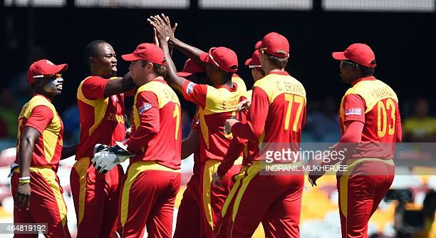 Teammates congratulate Zimbabwe bowler Tendai Chatara for taking the wicket of Pakistan cricketer Nasir Jamshed during the 2015 Cricket World Cup...