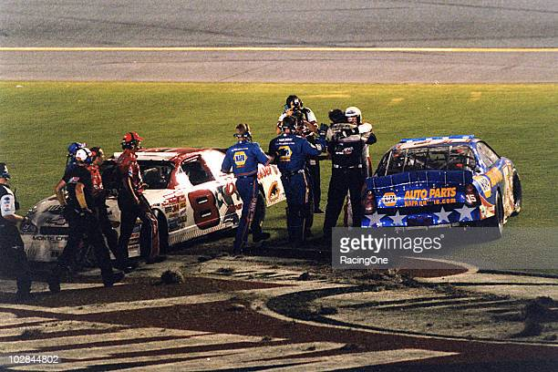 Teammates Dale Earnhardt Jr and Michael Waltrip celebrate finishing 12 in the Pepsi 400 NASCAR Cup race at Daytona International Speedway