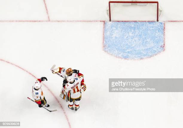 Teammates David Rittich TJ Brodie and Mikael Backlund of the Calgary Flames celebrate their win against the Ottawa Senators at Canadian Tire Centre...
