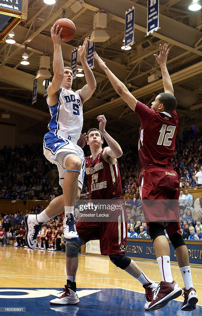 Teammates Dennis Clifford #24 and Ryan Anderson #12 of the Boston College Eagles try to stop Mason Plumlee #5 of the Duke Blue Devils during their game at Cameron Indoor Stadium on February 24, 2013 in Durham, North Carolina.