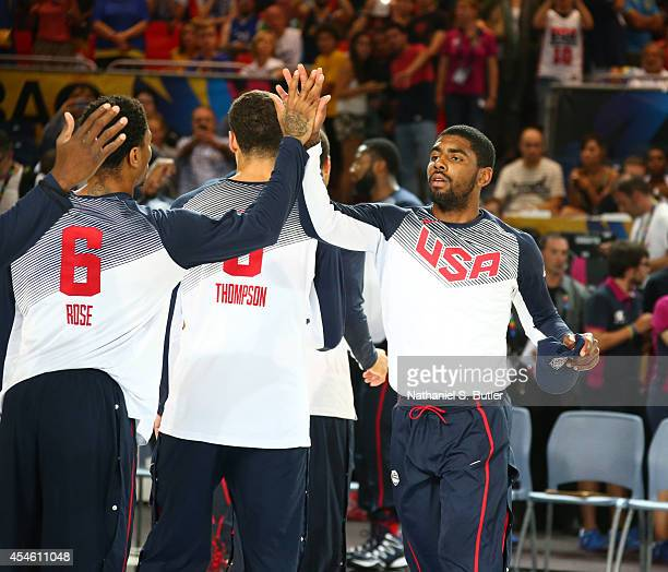 Teammates Derrick Rose and Kyrie Irving of the USA Basketball Men's National Team highfive prior to playing a game against the Ukraine Basketball...