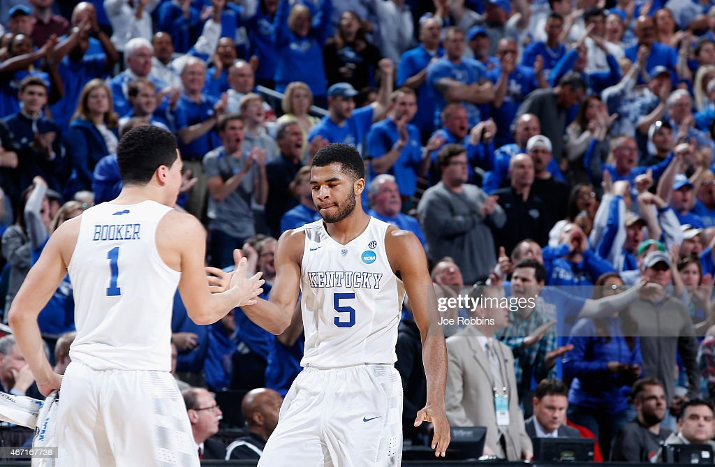 Teammates Devin Booker #1 and Andrew Harrison #5 of the Kentucky Wildcats react against the Cincinnati Bearcats during the third round of the 2015 NCAA Men's Basketball Tournament at KFC YUM! Center on March 21, 2015 in Louisville, Kentucky.