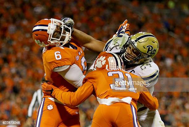 Teammates Dorian O'Daniel and Ryan Carter of the Clemson Tigers try to stop James Conner of the Pittsburgh Panthers during their game at Memorial...