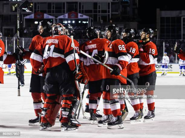 Teammates Erik Karlsson and Craig Anderson of the Ottawa Senators celebrate their shutout win against the Montreal Canadiens during the of the 2017...