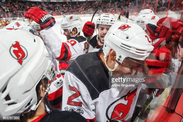 Teammates facewash John Moore of the New Jersey Devils as they celebrate his gamewinning overtime goal against the Ottawa Senators at Canadian Tire...