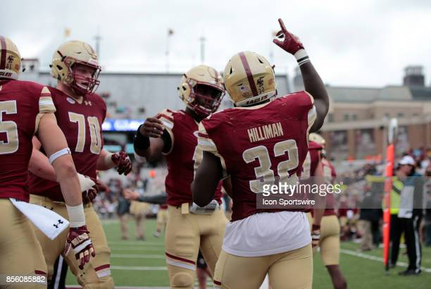 Teammates flock to Boston College running back Jon Hilliman after his second rushing touchdown of the game during a game between the Boston College...