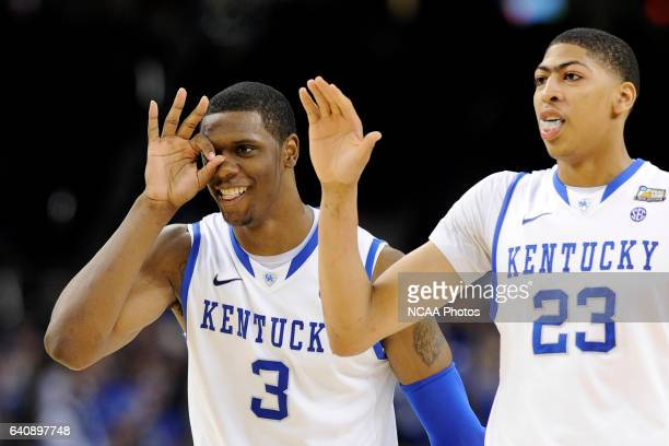 Teammates forward Terrence Jones and Anthony Davis from the University of Kentucky celebrate in the final minutes during the Championship Game of the...