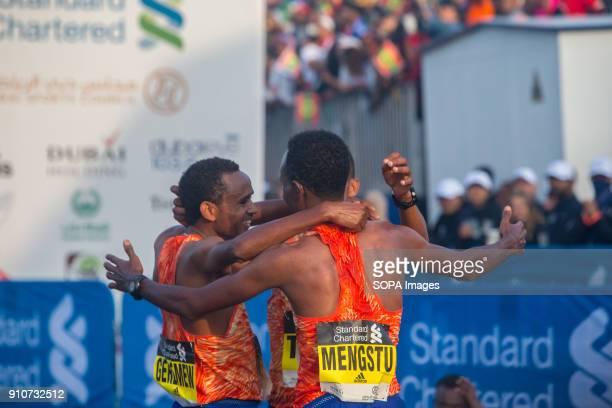 Teammates from Ethiopia celebrate after finishing the Standard Chartered Dubai Marathon