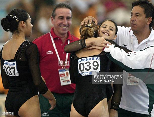 Teammates Gabriela Leal and Iyerida Mogollon and coaching members congratulate Mexican gymnast Brenda Magana after her perfomance on the floor during...
