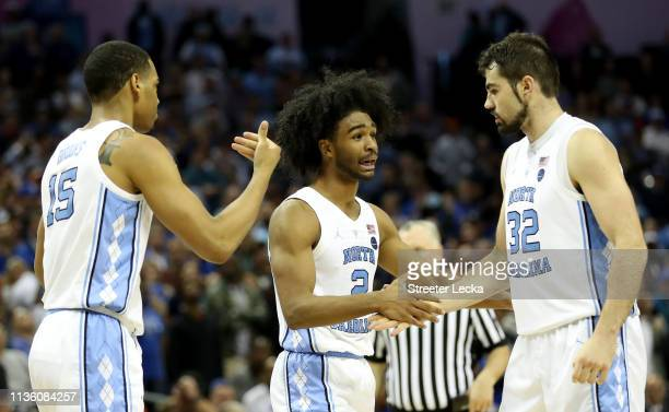 Teammates Garrison Brooks Coby White and Luke Maye of the North Carolina Tar Heels react against the Duke Blue Devils during their game in the...