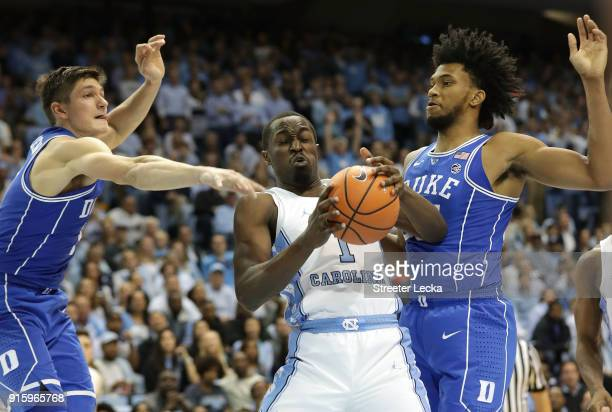 Teammates Grayson Allen and Marvin Bagley III of the Duke Blue Devils go after a loose ball against Theo Pinson of the North Carolina Tar Heels...