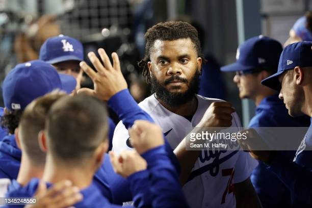 Teammates greet Kenley Jansen of the Los Angeles Dodgers in the dugout after the top of the ninth inning against the St. Louis Cardinals during the...