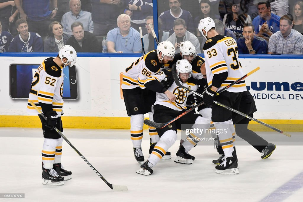 Teammates help an injured Boston Bruins right wing David Backes (42) to his  feet 41881458c