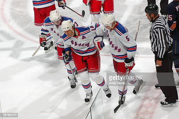 Teammates help Brendan Shanahan of the New York Rangers off the ice after he was hit by Dustin Penner of the Edmonton Oilers at Rexall Place on...