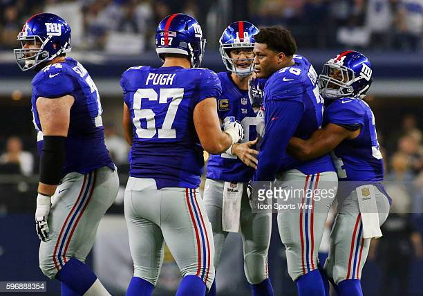 Teammates hold New York Giants offensive tackle Ereck Flowers back from Dallas Cowboys defenders during a NFL regular season game between the New...
