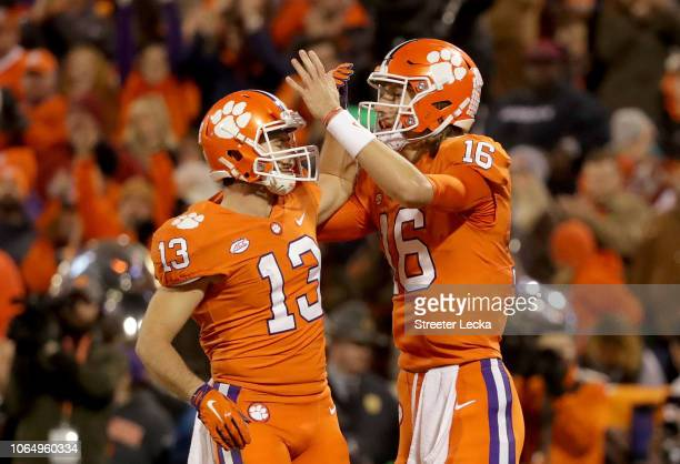 Teammates Hunter Renfrow and Trevor Lawrence of the Clemson Tigers react after a play against the South Carolina Gamecocks during their game at...