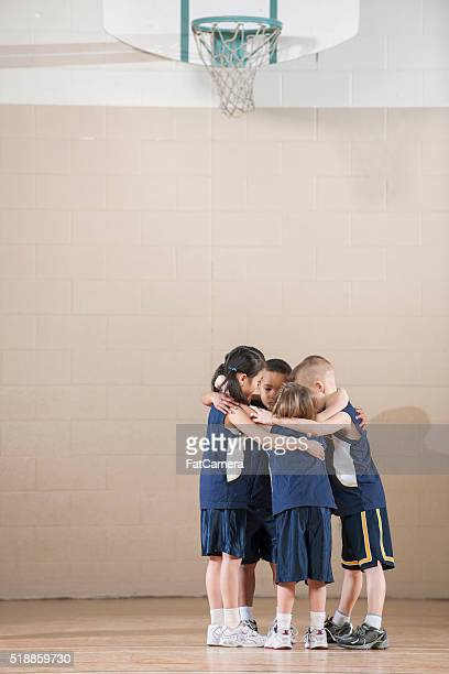 Teammates in a Group Huddle