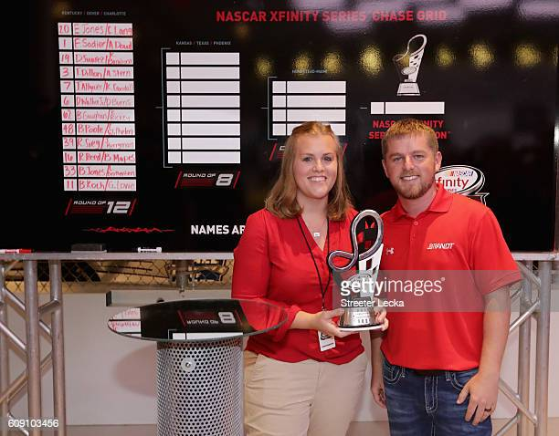 Teammates in the race simulator challenge Kelly Crandall and XFINITY Series driver Justin Allgaier celebrate after winning during the NASCAR XFINITY...