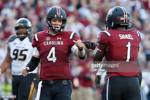 Teammates Jake Bentley and Deebo Samuel of the South Carolina Gamecocks react after a play against the Missouri Tigers during their game at...