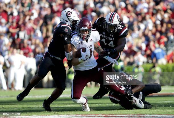 Teammates Jamyest Williams and Sherrod Greene of the South Carolina Gamecocks try to stop Jace Sternberger of the Texas AM Aggies during their game...