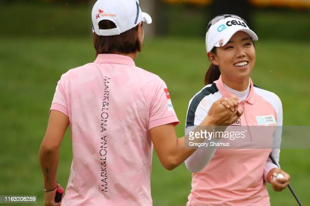 Teammates Jenny Shin and Na Yeon Choi of South Korea celebrate a eagle on the fifth green during the final round of the Dow Great Lakes Bay...