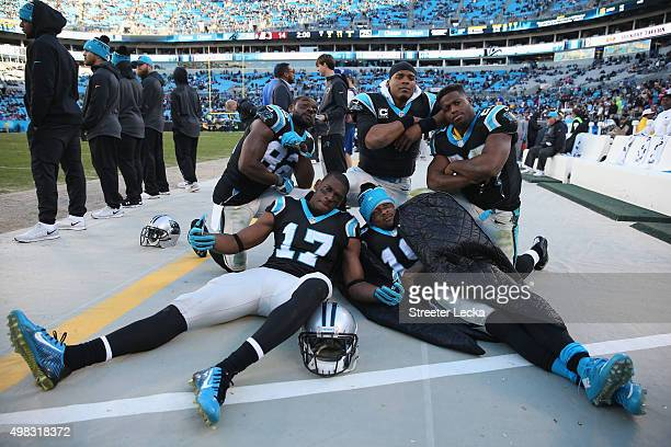 Teammates Jerricho Cotchery Devin Funchess Ted Ginn Jonathan Stewart and Cam Newton of the Carolina Panthers celebrate after defeating the Washington...