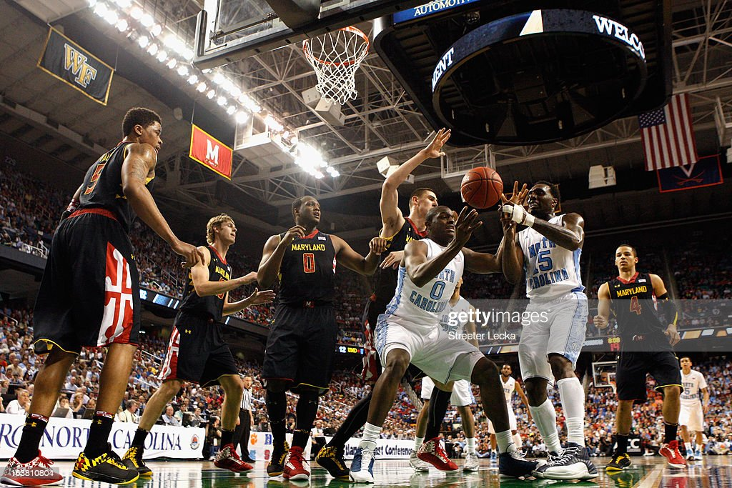 Teammates Joel James #0 and P.J. Hairston #15 of the North Carolina Tar Heels grab a loose ball against the Maryland Terrapins during the semifinals of the Men's ACC Basketball Tournament at Greensboro Coliseum on March 16, 2013 in Greensboro, North Carolina.