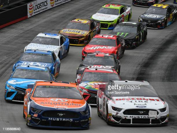 Teammates Joey Logano Team Penske Ford Mustang Shell Autorader and Brad Keselowski Team Penske Ford Mustang Discount Tire lead the field to a restart...