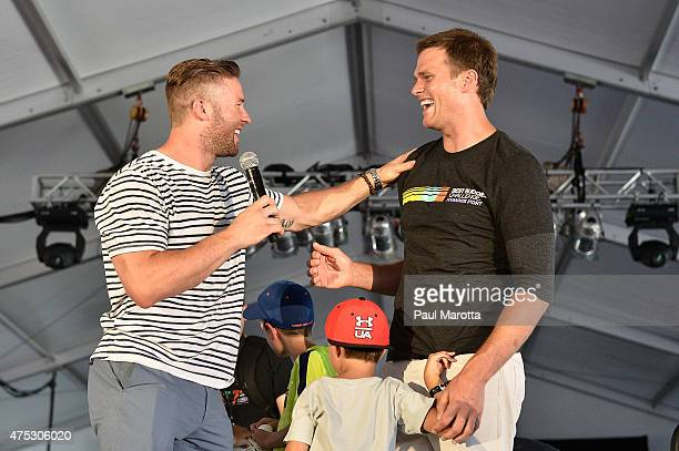 Teammates Julian Edelman and Tom Brady speak on stage at the Finish Line and Victory Celebration Party during the Best Buddies Challenge Hyannis Port...
