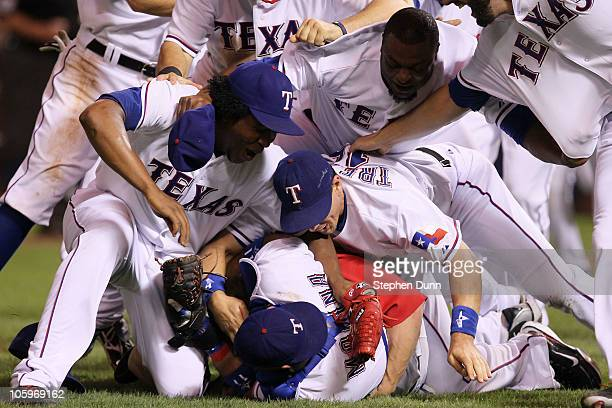 Teammates jump on top of Bengie Molina of the Texas Rangers after defeating the New York Yankees 61 in Game Six of the ALCS to advance to the World...