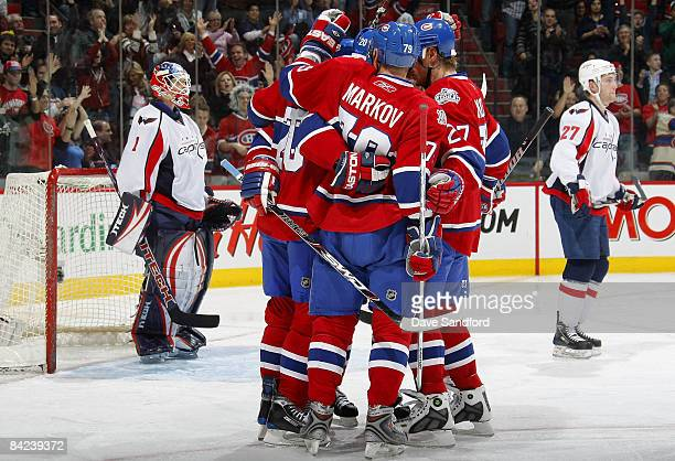Teammates Karl Alzner and Brent Johnson of the Washington Capitals stand in the background as Robert Lang Andrei Markov and Alex Kovalev all of the...