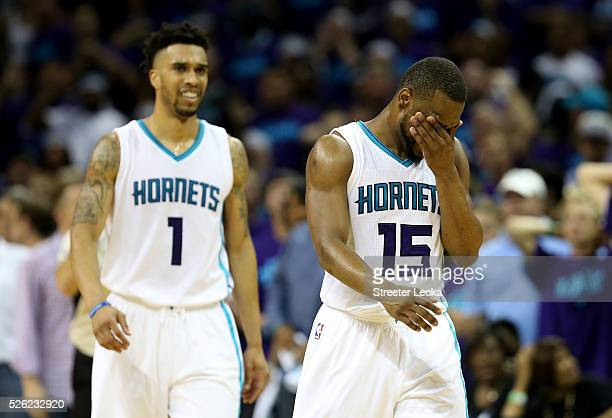 Teammates Kemba Walker and Courtney Lee of the Charlotte Hornets react after a call against the Miami Heat during game six of the Eastern Conference...