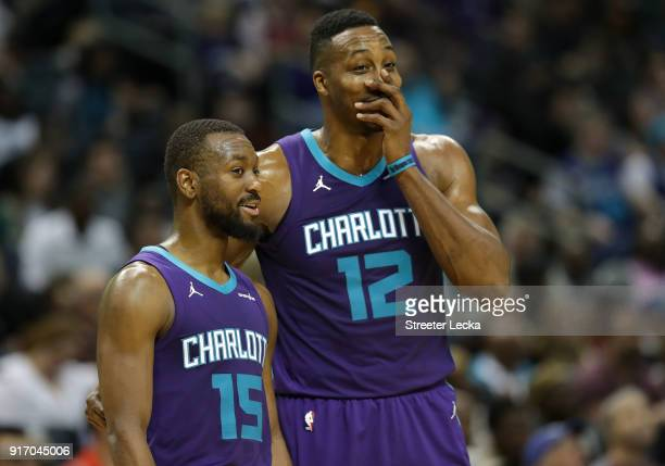 Teammates Kemba Walker and Dwight Howard of the Charlotte Hornets react against the Toronto Raptors during their game at Spectrum Center on February...