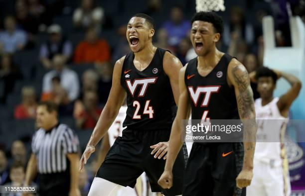 Teammates Kerry Blackshear Jr #24 and Nickeil AlexanderWalker of the Virginia Tech Hokies react against the Florida State Seminoles during their game...
