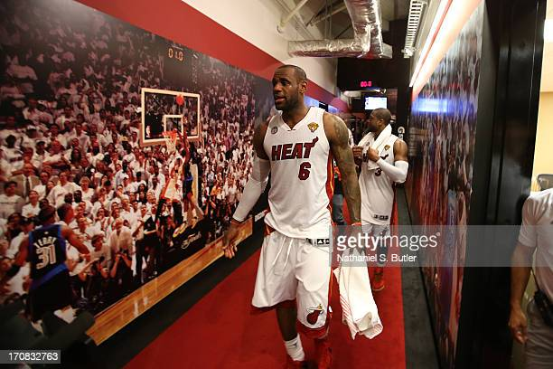 Teammates LeBron James and Dwyane Wade of the Miami Heat after playing against the San Antonio Spurs in Game Six of the 2013 NBA Finals on June 18...