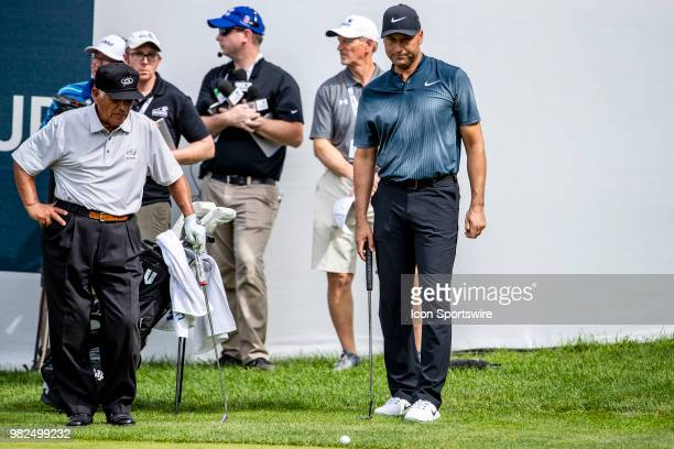 Teammates Lee Trevino and former New York Yankee Derek Jeter read their putt during a 4 man charity scramble during American Family Insurance...