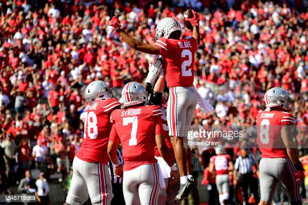 Teammates lift Chris Olave of the Ohio State Buckeyes after his touchdown in the third quarter during a game against the Maryland Terrapins at Ohio...