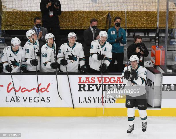 Teammates look on as Patrick Marleau of the San Jose Sharks reacts as he is honored as he plays in his 1,768th NHL game during a break in the first...